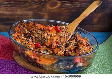 Vegan Baked Dish In Glass Pan, Pumkin, Vegetables, Herbs, Cheese