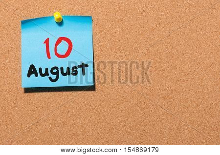 August 10th. Day 10 of month, color sticker calendar on notice board. Summer time. Empty space for text.