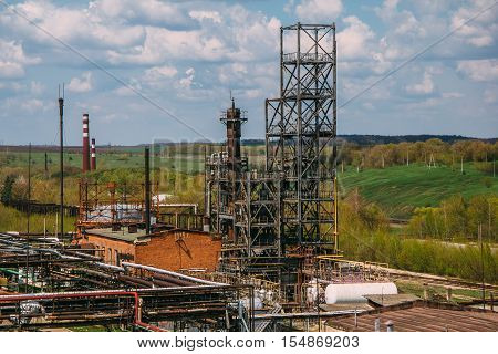 Towers in factory of synthetic rubber in Efremov, Tula Region poster
