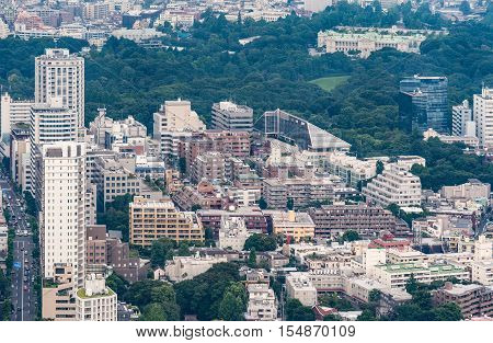 Tokyo Japan - September 26 2016: Aerial view since shot off Observatory tower. Government Office sits in its own large park. All surrounded by highrises and other buildings.