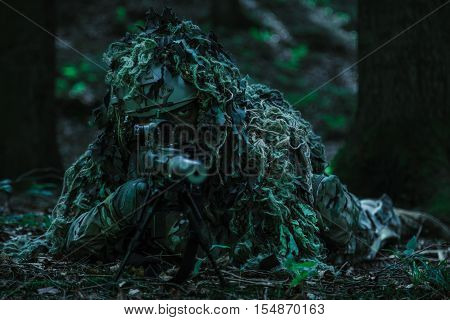 United states army ranger sniper wearing ghillie suit