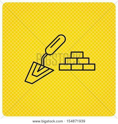 Finishing icon. Spatula with bricks sign. Linear icon on orange background. Vector