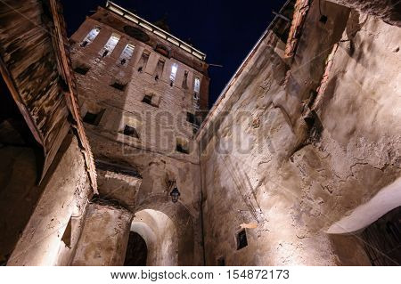 View to the watch tower at night in Sighisoara town, Romania