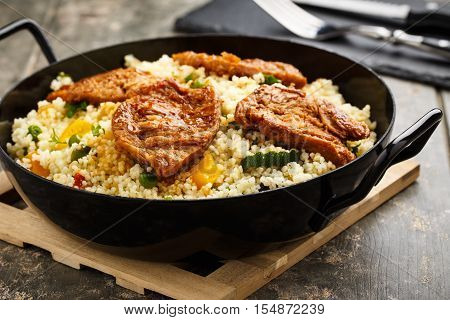 fresh cous cous with mixed grilled vegetables and soy medaillons.