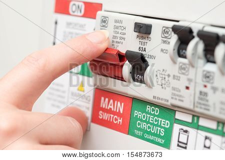 Finger On Main Switch On Rcd Circuit Breaker Board