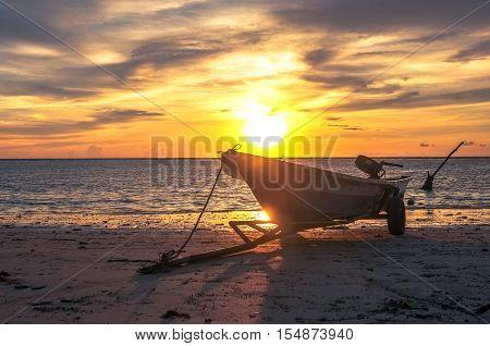 Fisherman boat at Labuan beach during beautiful sunset at Labuan tropical island,nature background.