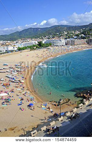 Tossa De Mar, Spain - August 2, 2014: View of the town beach in Tossa de Mar, Catalonia.