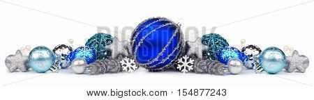 Christmas Border Of Blue And Silver Ornaments On A White Background