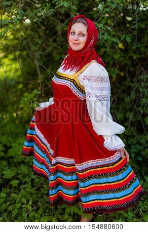 A young Slavic woman in national costume. Byelorussian
