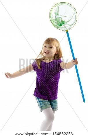 Joyful little girl runs after a butterfly with a butterfly net.Isolated on white background.