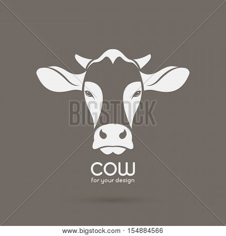 Vector image of a cow head design on brown background Vector cow logo. Farm Animals.