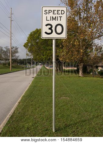 30 MPH Speed Limit Sign in a residential area in Lake Wales Florida