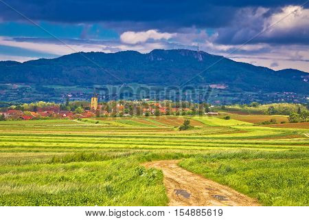 Village of Miholec church tower and Kalnik mountain view Prigorje Croatia