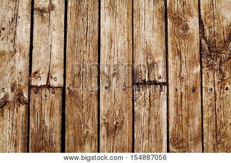 Closeup of wooden planks of fence boardwalk texture background. Vertical and horizontal lines