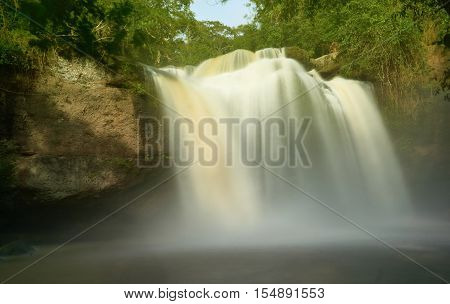 A big waterfall in afternoon sunlight. Haew Suwat waterfall, a large waterfall at Khao Yai National Park, Thailand.