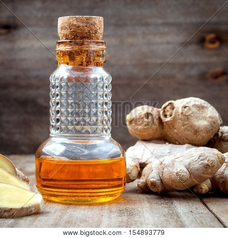 =alternative Medicine And Nature Spas Ingredients . Ginger Root And Ginger Essential Oil Set Up On O