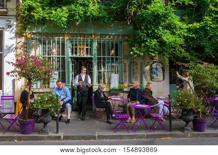 Paris France - October 16 2016: Cafe on the Ile de Cite with unidentified people. Ile de Cite is a Seine Island it is the centre of Paris and the location where the medieval city was refounded.