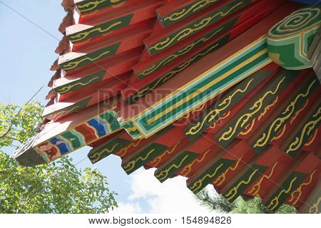 Architectural details of chinese traditional roof. Bottom view on the chinese cornice.