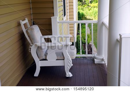 A lounge chair on the front porch of a Victorian home on Fourth Street in Harbor Springs, Michigan.