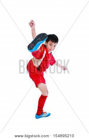 Full body portrait of playful young asian soccer player in red uniform smiling and looking at camera studio shot. Isolated on white background.