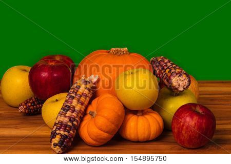 apples pumkins gourds and corn on a green (chroma Key) background
