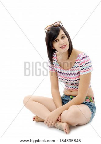 pretty young brunette woman sitting cross-legged isolated on white background