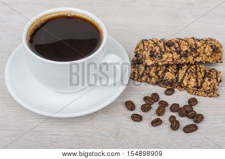 Cup Of Black Coffee, Cereal Bars And Coffee Beans