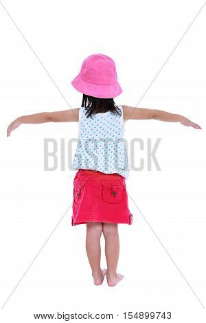 Back view of asian child posing in the studio isolated on white background. Girl raising arms. Studio shot.