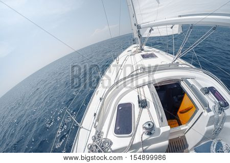 Sailing vessel moving with open sail in the sea