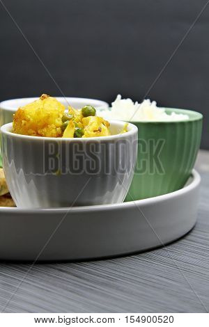 A bowl of Cauliflower and peas curry on a platter selective focus.
