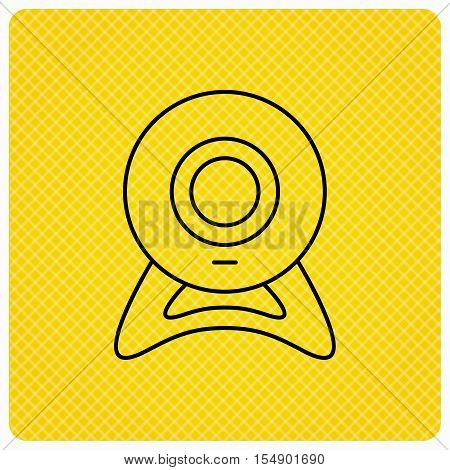 Web cam icon. Video camera sign. Online communication symbol. Linear icon on orange background. Vector