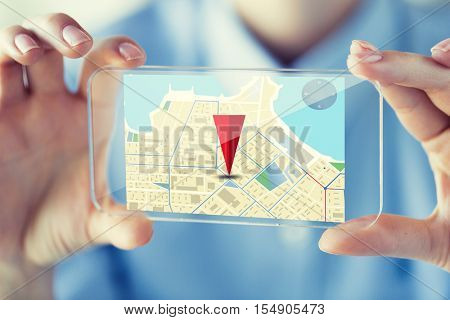 business, technology, navigation, location and people concept - close up of woman hand holding and showing transparent smartphone with gps navigator map on screen at office
