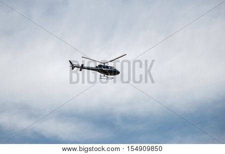 KIDRON VALLEY, ISRAEL - MARCH 5, 2011: Tourist helicopter in israel`s sky