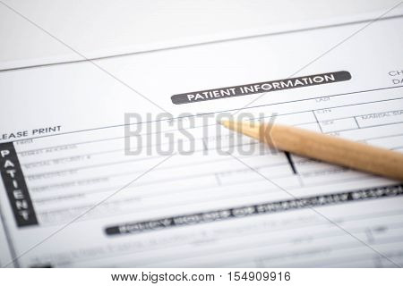 Patient information form and pen on deskMedical questionnaire