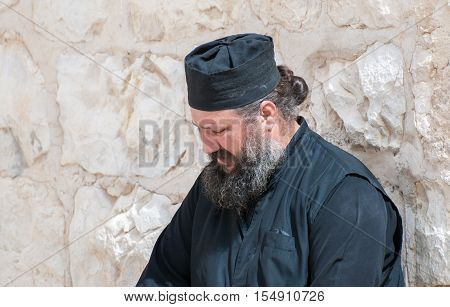 KIDRON VALLEY, ISRAEL - MARCH 5, 2011: Orthodox monk at Holy Lavra of Saint Sabbas the Sanctified, known in Arabic as Mar Saba
