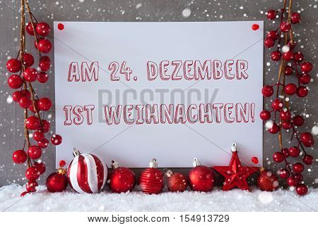 Label With German Text Am 24. Dezember Ist Weihnachten Means December 24th Is Christmas Eve. Red Christmas Decoration Like Balls On Snow. Urban And Modern Cement Wall As Background With Snowflakes.