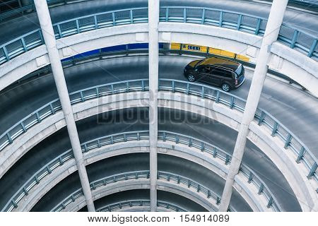 Car driving in multi storey car park.