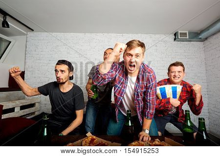 Friends Sprot Watching On Tv, Have Fun, Eat Pizza. Friends To Eat Pizza, Drink Alcohol, Shout And La