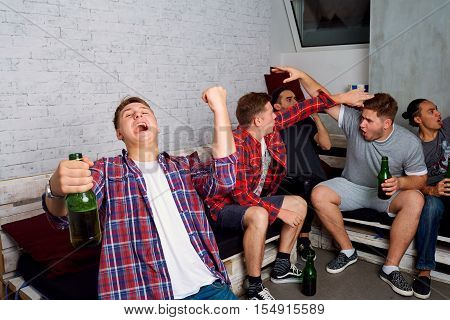 Friends Cheering For Your Team Together. Concept Sports Fans. Friends Drink Beer And Watch Tv.
