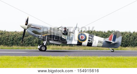Leeuwarden, The Netherlands - June 10, 2016: A Vintage Spitfire Fighter Plane On The Runway During A