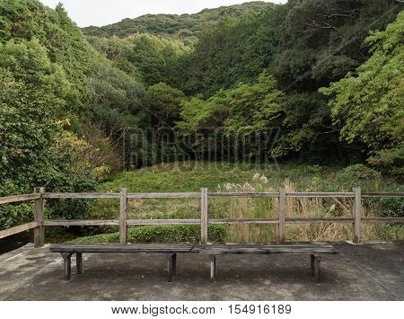 old wooden chairs in Japaness garden and mountain veiw background