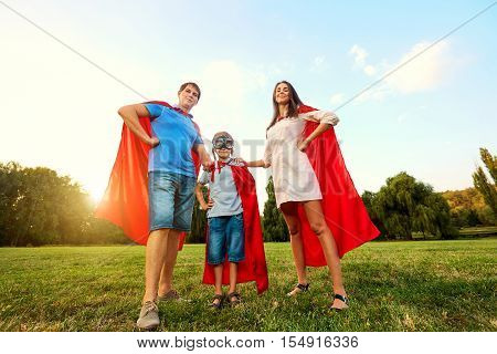 Superheroes Family. Mother, Father And Son In The Costumes Of Superheroes In Nature. Mother's Day, F