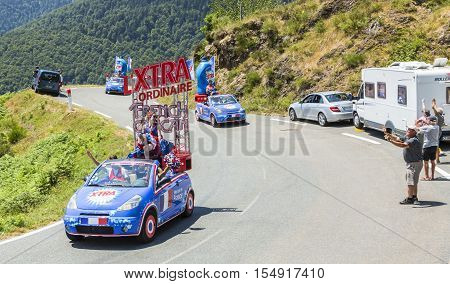 Col D'AspinFrance- July 15 2015: X-tra Total Caravan during the passing of the Publicity Caravan on the Col d'Aspin in Pyerenees Mountains in the stage 11 of Le Tour de France 2015.X-tra Total is a good detergent for all fabrics produced by Henkel.
