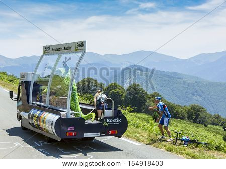 Col D'AspinFrance- July 15 2015: Bostik Vehicle during the passing of the Publicity Caravan on the Col d'Aspin in Pyerenees Mountains in the stage 11 of Le Tour de France 2015. Cofidis is an important French money lending company. Bostik is a leading glob