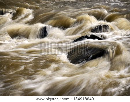 abstract background Wild turbid water in the river after rain