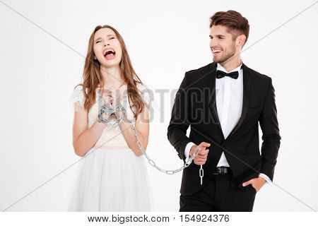 Man binding his woman with chain. White background