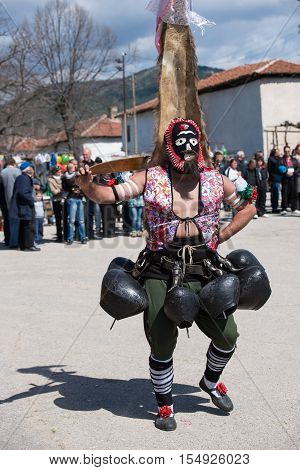 Paisievo, Bulgaria - March 26, 2016: People in costumes are taking part in the festival of Mummers in Paisievo, Bulgaria. People dressed in different costumes dance and preform rituals to scare the evil spirits.