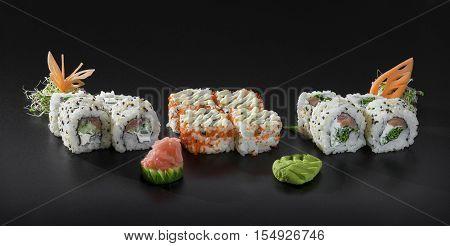 Fresh set of Uramaki sushi rolls decorated with Japanese mayonnaise and sesame