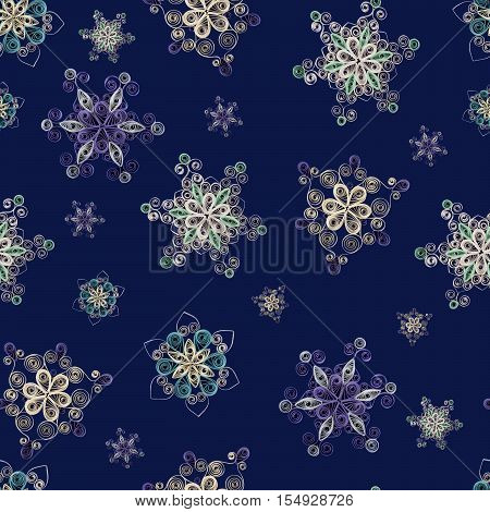 Seamless pattern made of handmade paper snowflakes in quilling technigue on dark blue background. Can be used as Christmas background for cards wrapping paper.