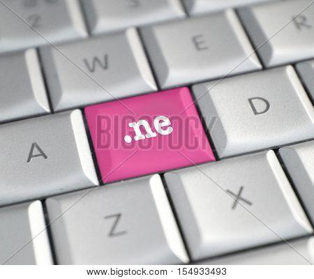 The .ne domain name on a keyboard key